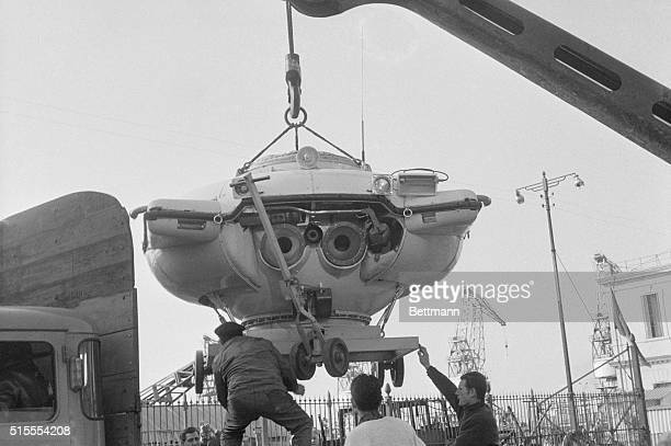 The French diving saucer built by scientist commandant Jacques Cousteau looks like a monster as it is lifted from the Cousteau ship Calypso to a...