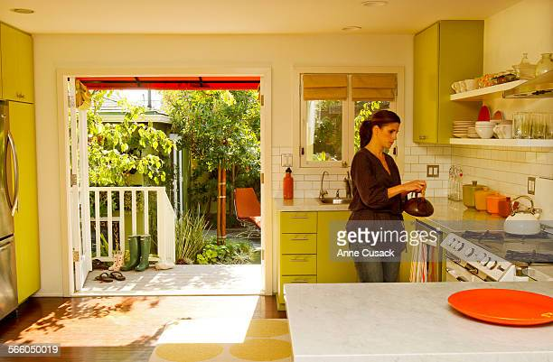The French doors off the kitchen open to the backyard garden at the home of Elizabeth and David Low and their two year old daughter Violet in the Mar...
