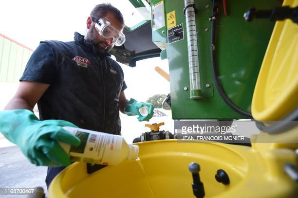 The French farmer Fabien Denis prepares an insecticide before spraying in a field at the request of the inhabitants of SaintMarsduDesert because an...