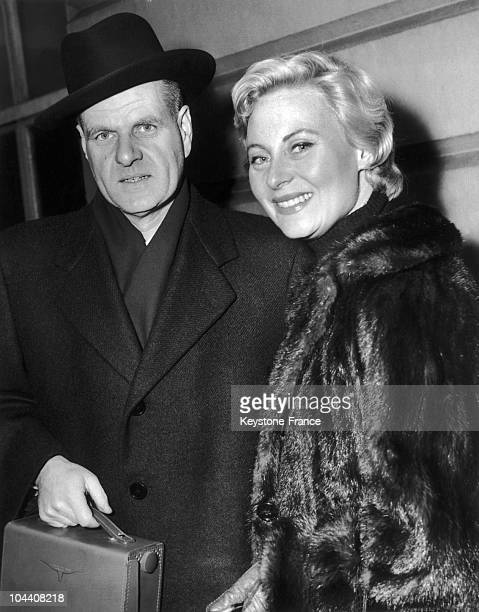 The French film maker Jean DELANNOY and the actress Michele MORGAN pictured upon their arrival in London on February 8 where they were to proceed...