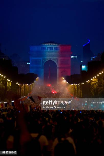 The French flag and Fiers D'etre Bleus in reference to the French national team's nickname Les Bleus is projected onto the Arc de Triomphe as fans...
