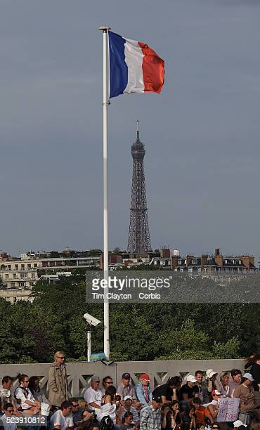 'The french flag flies above the stadium at Roland Garros with the Eiffel Tower in the background during the French Open Tennis Tournament Finals...