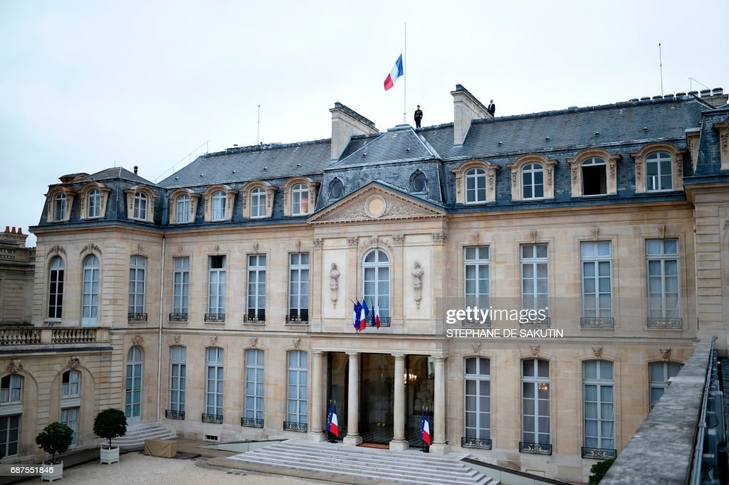 The French flag flies at half mast at the Elysee presidential Palace in Paris on May 24, 2017 in tribute to the victims of the May 22 terror attack at the Ariana Grande concert at the Manchester Arena that killed 22 and injured dozens. Police on May 23 named a young man -- reportedly British-born of Libyan descent -- as the suspect behind a suicide bombing that ripped into young fans at a concert in Manchester, as the Islamic State group claimed responsibility for Britain's deadliest terror attack in over a decade. /
