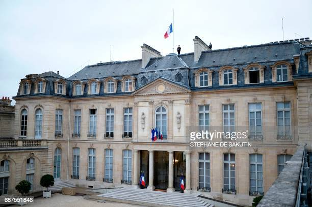 The French flag flies at half mast at the Elysee presidential Palace in Paris on May 24, 2017 in tribute to the victims of the May 22 terror attack...