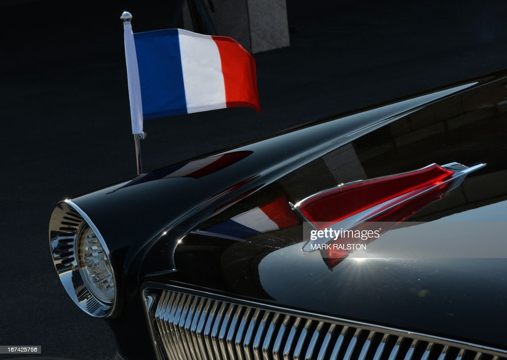The French flag flies on the Chinese-made Hongqi limousine used by the French President Francois Hollande after his arrival in Beijing on April 25, 2013. French President Francois Hollande, accompanied by a high-powered business delegation, started a two-day visit to China, with trade rather than geopolitics at the top of the agenda. For Hollande, beset by economic woes and the aftermath of a damaging corruption scandal that forced his budget minister to resign, it will be a welcome break from his domestic troubles. AFP PHOTO/Mark RALSTON