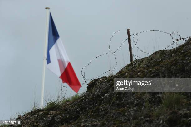 The French flag flies over barbed wire on top of the remains of Fort Vaux on August 27 2014 near Verdun France Fort Vaux was one of a string of...