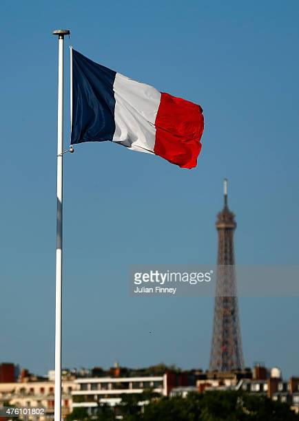 The French flag flies over Court Philippe Chatrier with The Eiffel tower seen in the background during the Women's Singles Final on day fourteen of...