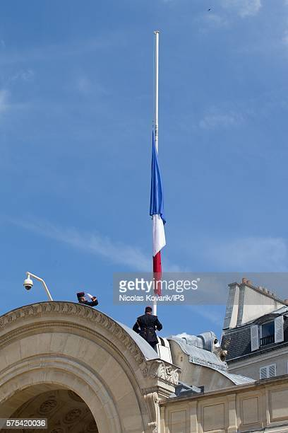 The French flag is at half mast after a Security and Defense Council chaired by French President Francois Hollande at the Elysee Palace on July 15...