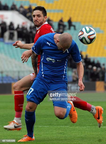 The French football player of CSKA Sofia Jeremy Faug-Porret fights for the ball with Levski Sofia's Pavel Cmovs from the Czech Republic during their...