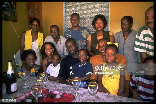 The French footballer drinks champagne with his family On his right his wife Sandra