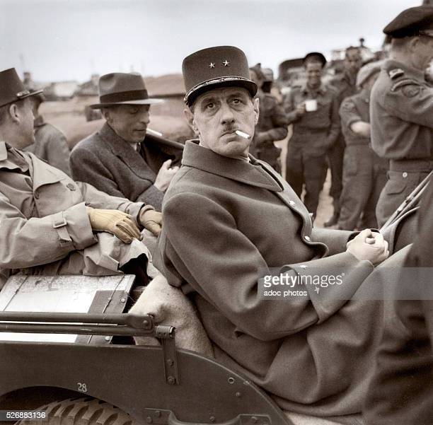 WWII The French general Charles de Gaulle in a jeep few days after the Invasion of Normandy by the Allied forces June 14 1944 Coloured photograph