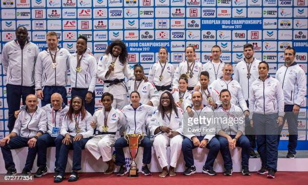 The French gold medal winning women's team and the two medal winning men of Axel Clerget Audrey Tcheumeo Melanie Clement Sama Hawa Camara Margaux...