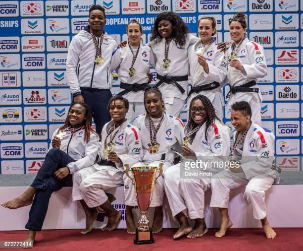 The French gold medal winning women's team of Audrey Tcheumeo Melanie Clement Sama Hawa Camara Margaux Pinot Helene Receveaux Priscilla Gneto Emilie...