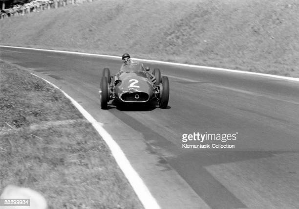 The French Grand Prix Rouenles Essarts July 7 1957 A classic image by Edward Eves Juan Manuel Fangio in a full four wheel drift at well over 100 mph...