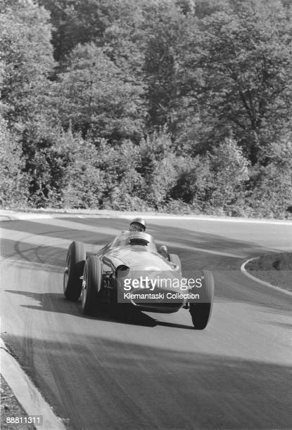 The French Grand Prix RouenLes Essarts July 7 1957 Juan Manuel Fangio drifts the Maserati 250F through one of Rouen's corners in the forest on the...
