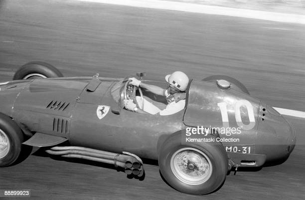 The French Grand Prix Rouenles Essarts July 7 1957 Luigi Musso accelerating out of Nouveau Monde corner in his Ferrari 801/F1 He would finish second...