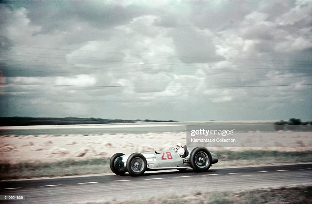 The French Grand Prix;Reims-Gueux, July 3, 1938. Hermann Lang at speed in his Mercedes W154 through the wheat fields of eastern France.