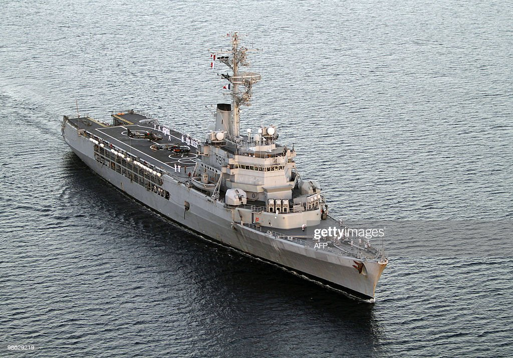 The French helicopter-carrier Jeanne d'Arc, a Naval Academy 182-metre-long ship carrying a crew of 585 officers and sailors, arrives in Fort-de-France harbor during its last trip as training vessel, on March 16, 2010.