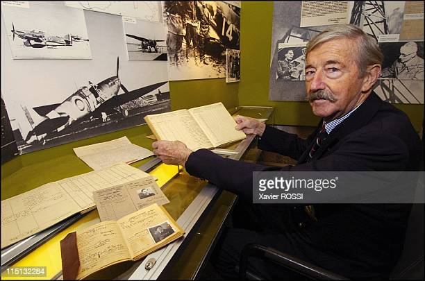 The French heroes of D-Day in Besancon, France in March, 2004 - Henri Mathey, D-day pilot, reads his log book in the Museum of Free French Forces in...