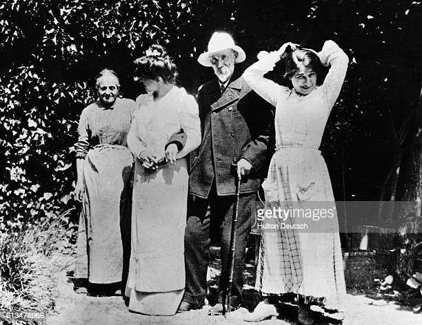 The French impressionist painter Pierre Auguste Renoir in the garden at Les Collettes with members of his family and model Gabrielle