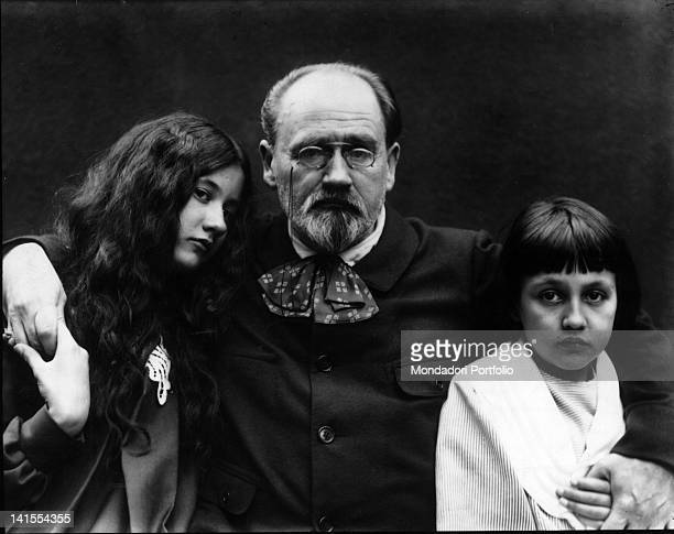 The French journalist essayist and novelist Emile Zola hugging two girls 1890s