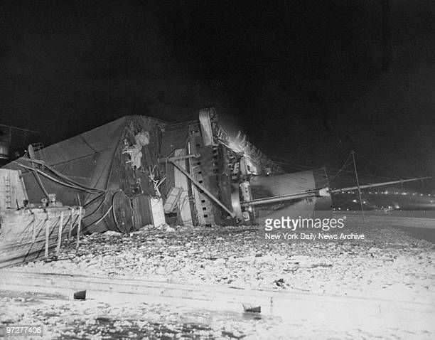 The French luxury liner Normandie lies capsized in its berth at W 49th St a victim of fire and water The mighty vessel rolled over majestically at...