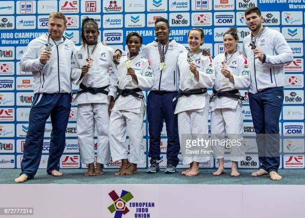 The French medallists pose for the photographers Axel Clerget Marie Eve Gahie Priscilla Gneto Audrey Tcheumeo Margaux Pinot Helene Receveaux and...