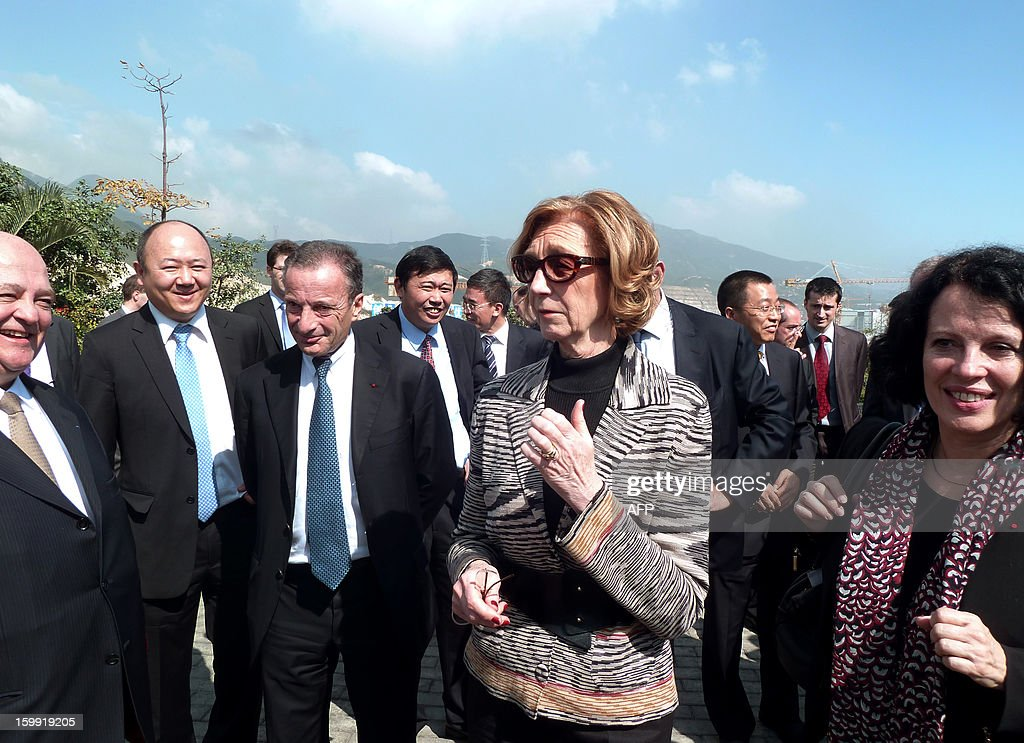 The French Minister for Foreign Trade Nicole Bricq (Center R) speaks with members of a delegation, including the CEO of France's state-owned electricity company EDF, Henri Proglio (3rd L), the French ambassador to China, Sylvie-Agnes Bermann (R), and other French and Chinese officials of the Taishan Nuclear Power Joint Venture Company (TNPJVC), during a visit and presentation on progress being made in building two new French-designed EPR nuclear power plants, Taishan 1 and 2, in Taishan, on January 22, 2013. The construction of the two Taishan nuclear power plants involves a 6 billion euro investment and 16 000 workers, and is managed by the joint French-Chinese venture Taishan Nuclear Power Joint Venture Company (TNPJVC), which is owned 70% by Chinese energy giant CGNPC and 30% by the French state-owned electricity company EDF. China, whose energy production is dominated by a 70 % use of coal, is the country in the world currently building the most nuclear plants.
