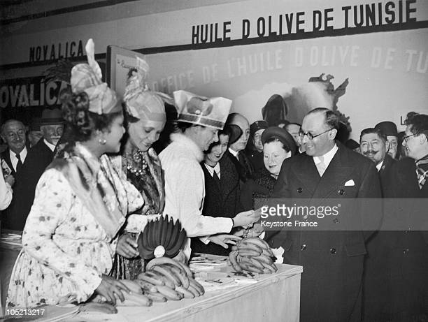 The French Minister Of National Education Jean Zay Visits A Stand Where Women From Martinique Sell Bananas At The Inauguration Of The Household...