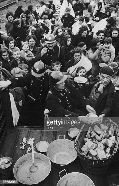 The French Mobile Guard hand out soup and bread to refugees from the Spanish Civil War as they arrive at Le Perthus on the French border 29th January...