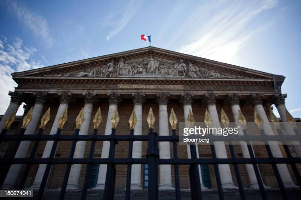 The French national flag flies atop the National Assembly building in Paris France on Wednesday Aug 22 2012 Europe's economy is edging toward a...