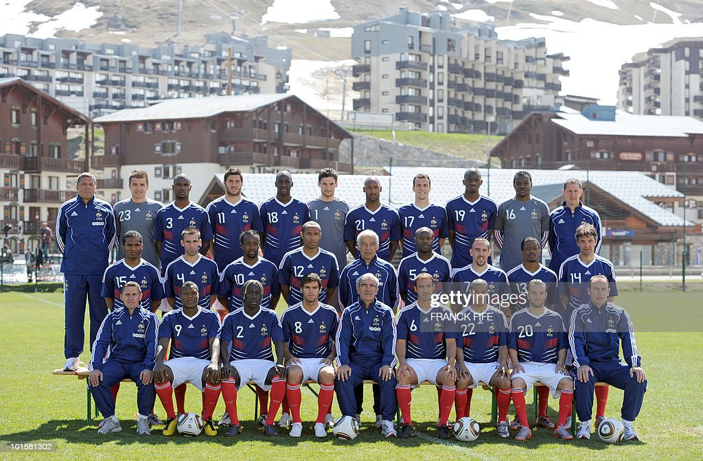 The French national football team and the technical staff pose prior to a training session on May 25, 2010 near Tignes in the French Alps, as part of the preparation for the upcoming World Cup 2010. France will play against Uruguay in Capetown in its group A opener match on June 11. (First row (up), LtoR, goalkeepers' coach Bruno Martini, goalkeeper Cedric Carasso, defender Eric Abidal, forward Andre-Pierre Gignac, midfielder Alou Diarra, goalkeeper Hugo Lloris, forward Nicolas Anelka, defender Sebastien Squillaci, midfielder Abou Diaby, goalkeeper Steve Mandanda and deputy goalkeepers' coach Fabrice Grange. Second row, LtoR, midfielder Florent Malouda, defender Anthony Reveillere, forward Sidney Govou, forward Thierry Henry, deputy coach Pierre Mankowski, defender William Gallas, midfielder Franck Ribery, defender Patrice Evra and midfielder Jeremy Toulalan. Third row, LtoR, Physical assistant Robert Duverne, forward Djibril Cisse, defender Bacary Sagna, midfielder Johan Gourcuff, coach Raymond Domenech, defender Marc Planus, defender Gael Clichy, forward Mathieu Valbuena and assistant coach Alain Boghossian.