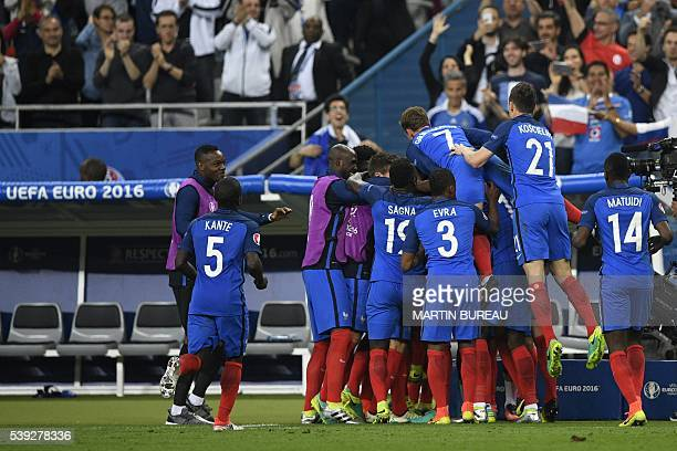 The French national team celebrates following the first goal of the match during the Euro 2016 group A football match between France and Romania at...