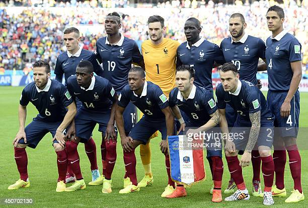 The French national team pose France's forward Antoine Griezmann France's midfielder Paul Pogba France's goalkeeper and captain Hugo Lloris France's...