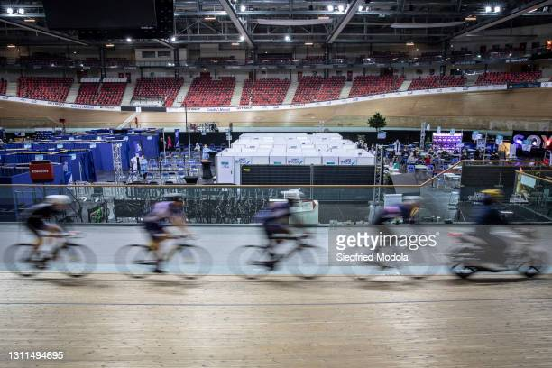 The French national team trains inside a velodrome which has been turned into a vaccination centre, on April 8, 2021 in Saint-Quentin-en-Yvelines,...