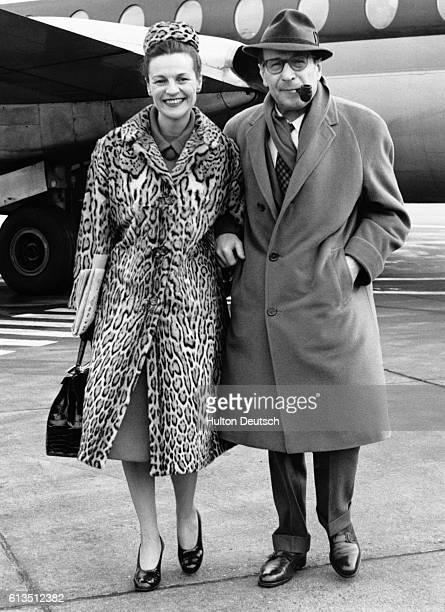 The French novelist Georges Simenon with his wife Denise, at London Airport, 1962. Simenon published over 500 novels and many short stories, but is...