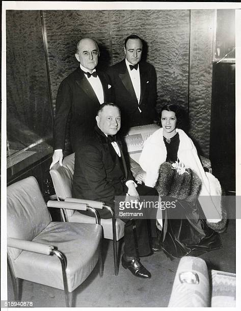 The French operatic singer, Lilly Pons, sits with three guests after the premiere of her debut film on November 29, 1935. She sits with David...