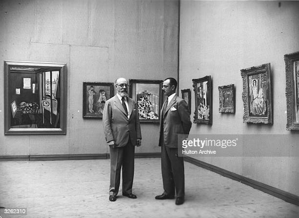 The French painter Henri Matisse at an exhibition of his work at the Galerie Georges Petit Paris The exhibition was organised by the collector...