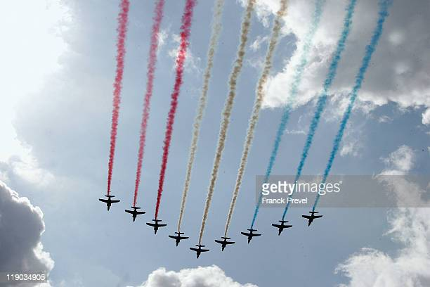 The French ''Patrouille de France'' alphajets fly colouring in the sky during the annual Bastille day parade on the ChampsElysees on July 14 2011 in...