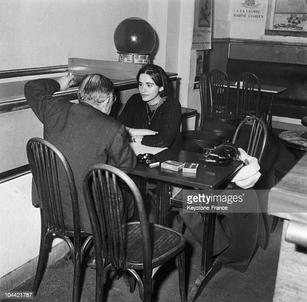 The French Philosopher JeanPaul Sartre Speaking With Arlette Elkaim His Secretary Who Asked To Be Adopted By The Writer In A Cafe In The Montparnasse...