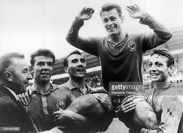 The French player Just FONTAINE who scored 13 goals is held in triumph by his team mates From left to right DOUIS Andre LEROND Just FONTAINE and Jean...