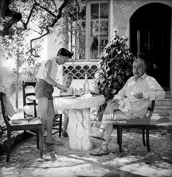 The French poet Jacques Prevert on vacation with his wife and little daughter relaxing during summer 1951 in Saint Paul de Vence, France.