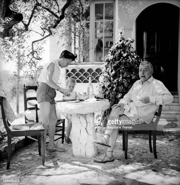 The French poet Jacques PREVERT relaxing while on vacation in St Paul de Vence in the summer of 1951, pictured on the terrace at his villa with his...