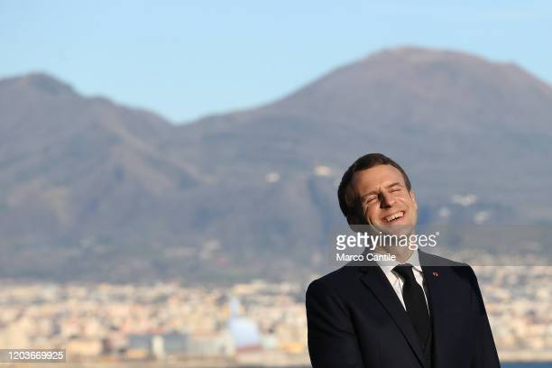 The French President, Emmanuel Macron, on a visit to Naples for the Italian-French summit, poses for a photo. Behind him Vesuvius.