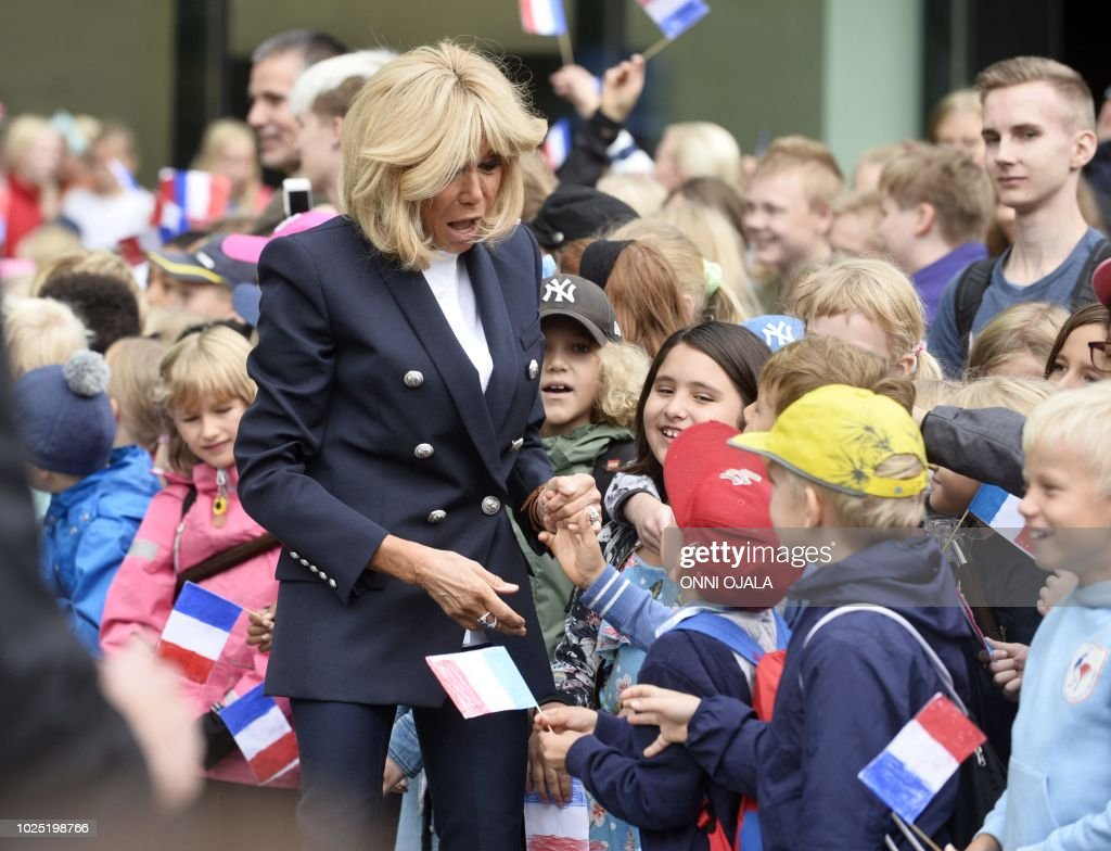 The French President S Wife Brigitte Macron Greets Children Waving News Photo Getty Images