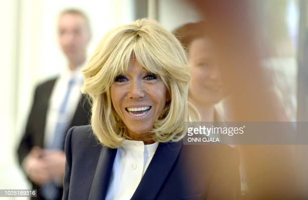 The French President's wife Brigitte Macron smiles as she visits the New Children's Hospital in Helsinki Finland during her visit on August 30 2018...