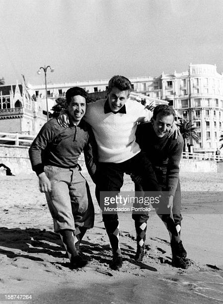 The French racing cyclist Jacques Anquetil having fun on the beach with French cyclists Pierre Rossi and Joseph Mirando Cannes 1st February 1958