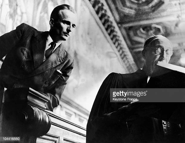 The French Resistance fighter Rene HARDY accused of having betrayed Jean MOULIN at his second trial with his lawyer Maurice GARCON in 1950