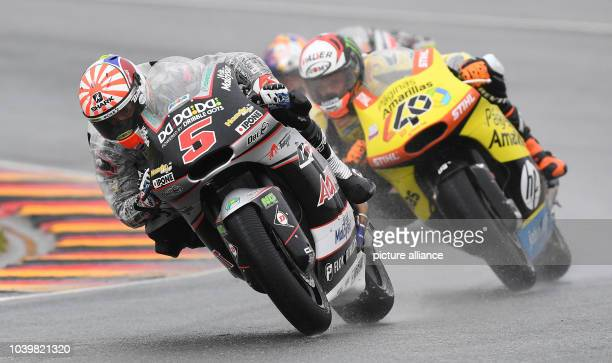 The French rider Johann Zarco Moto2 from Ajo Motorsport and the Spanish Moto2 rider Alex Rins from Paginas Amarillas HP 40 team on the track in the...