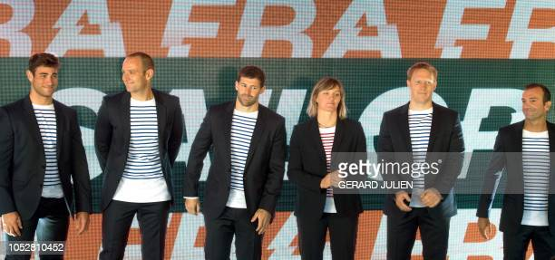 The French SailGP sailing team from left Timothe Lapauw Olivier Herledant Devan Le Bihan Marie Riou SailGPs first female onboard crew member Matthieu...